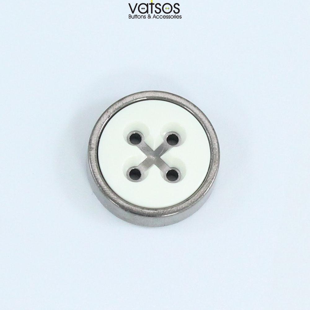 Πλαστικό κουμπί δίχρωμο με χιαστί στις τρύπες