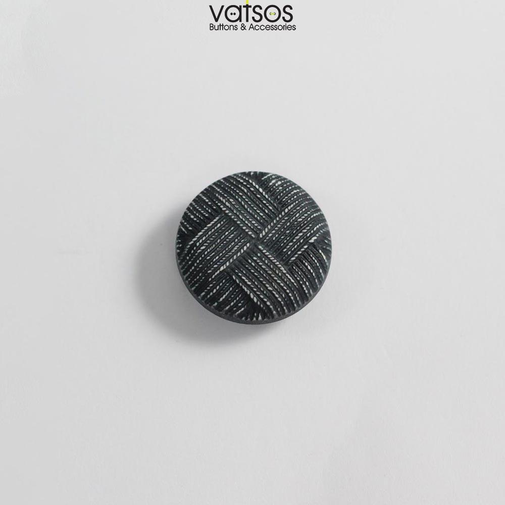 Πλαστικό κουμπί σε ύφος πλέξης